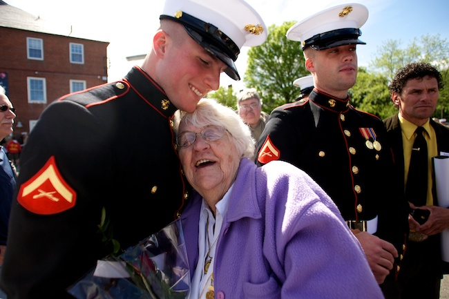 5.9.2010 —BOSTON — Florence Johnson, a Gold Star Mother and a mother and grandmother to two Marines and a veteran of World War II herself, gives a hug to Lance Corporal Timothy Potter at the closing ceremony for Marine Week at Charlestown Navy Yard on May, 9, 2010.