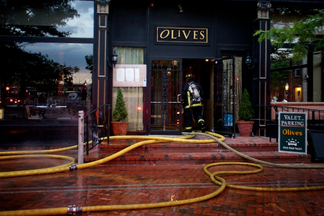5.27.2010 — BOSTON — A firefighter enters Olive's restaurant, 10 City Square in Charlestown, to check on the status of a fire on May 27, 2010.