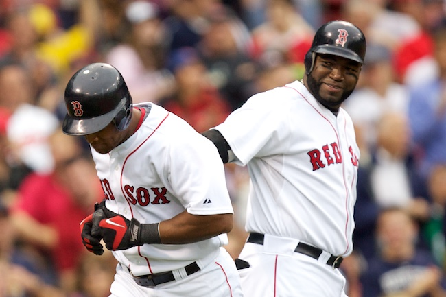 6.13.2010 —BOSTON — Red Sox third baseman Adrian Beltre gets a slap on the back from designated hitter David Ortiz after hitting a solo home run in the second inning against the Phillies on June 13, 2010.