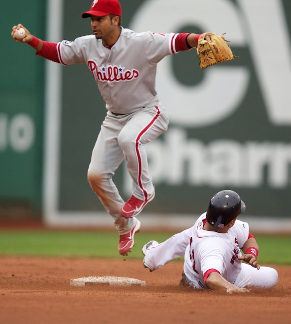 6.13.2010 — BOSTON — Phillies shortstop Juan Castro gets his double play attempt broken up by Red Sox catcher Victor Martinez in the sixth inning on June 13, 2010.