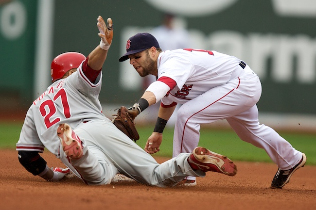 6.13.2010 — BOSTON —Phillies third baseman Placido Polanco slides in safely ahead of the tag from Red Sox second baseman Dustin Pedroia in the eighth inning on June 13, 2010.