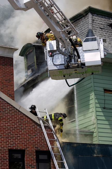 6.26.2010 — MARLBOROUGH, Mass. — Northborough firefighters, top, assist their Marlborough colleagues, below, with an 8-alarm fire at 173 Main St. in Marlborough on June 26, 2010.