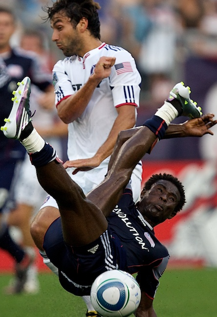 6.27.2010 — FOXBORO, Mass. — Revolution defender Emmanuel Osei misses on his bicycle kick clear ahead of Chicago midfielder Baggio Husidic on June 27, 2010.