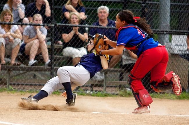 6.3.2010 —CAMBRIDGE, Mass. —Tewksbury catcher Lauren Teixeira tags out Arlington Catholic pinch runner Jessica Cameron at home in Arlington's 1-0 win over Tewksbury at St. Peter's Field in Cambridge on June 3, 2010.