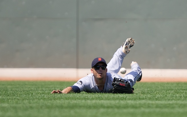 8.1.2010 —BOSTON — Tigers left fielder Ryan Rayburn can't make the play on Eric Patterson's RBI bloop hit into left field in the second inning on Aug. 1, 2010.