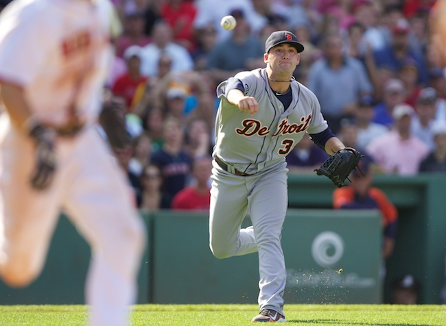 8.1.2010 — BOSTON — Tigers pitcher Robbie Weingardt throws the ball away in the ninth while trying to field a bunt from Marco Scutaro on Aug. 1, 2010. The error allowed pinch runner Darnell McDonald to score the go-ahead run, putting the Sox on top 4-3.