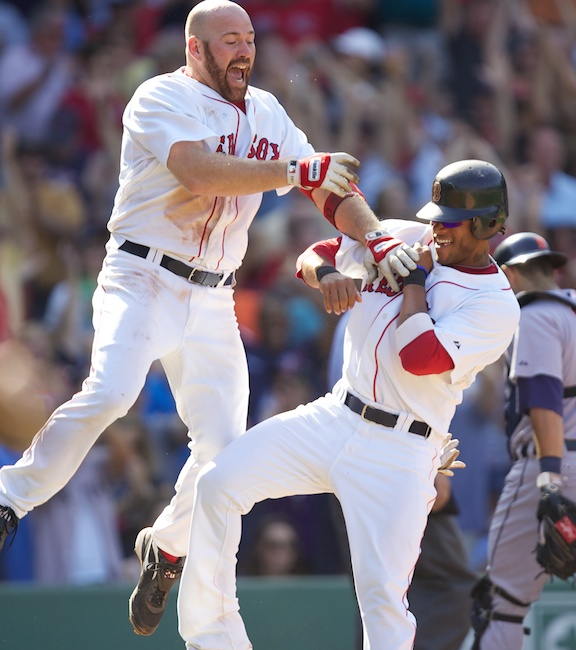 Red Sox first baseman Kevin Youkilis pounces on pinch runner Darnell McDonald after McDonald scored the game-winning run in the ninth inning on a Tigers error on Aug. 1, 2010.