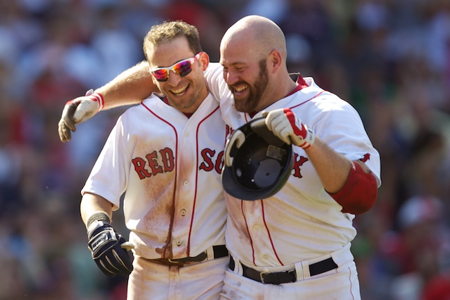 8.1.2010 — BOSTON — Red Sox first baseman Kevin Youkilis congratulates shortstop Marco Scutaro after Scutaro's bunt resulted in a game-ending error from Tigers pitcher Robbie Weinhardt in the ninth inning to put the Sox on top, 4-3, on Aug. 1, 2010.