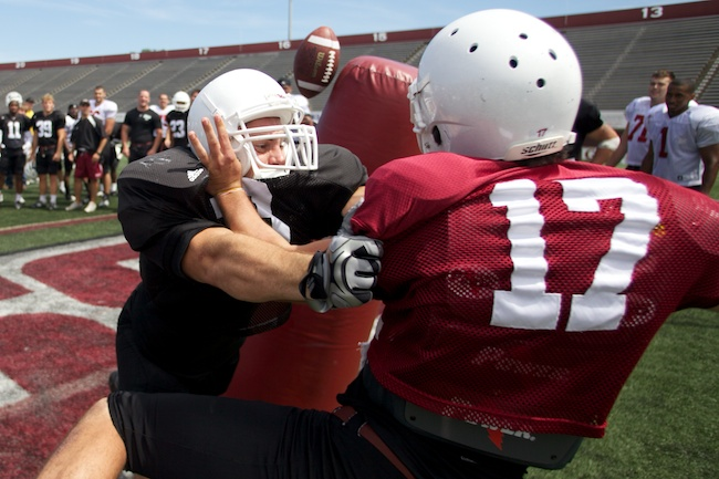 8.17.2010 — AMHERST, Mass. — UMass linebacker Mike Mele puts a hit on quarterback Jesse Hunt during a post-practice competition at McGuirk Stadium on Aug. 17, 2010.